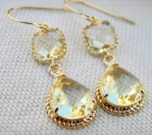 Image description: Citrine Yellow Earrings Gold with Teardrop Glass Gem and Square Block. [Via Etsy]