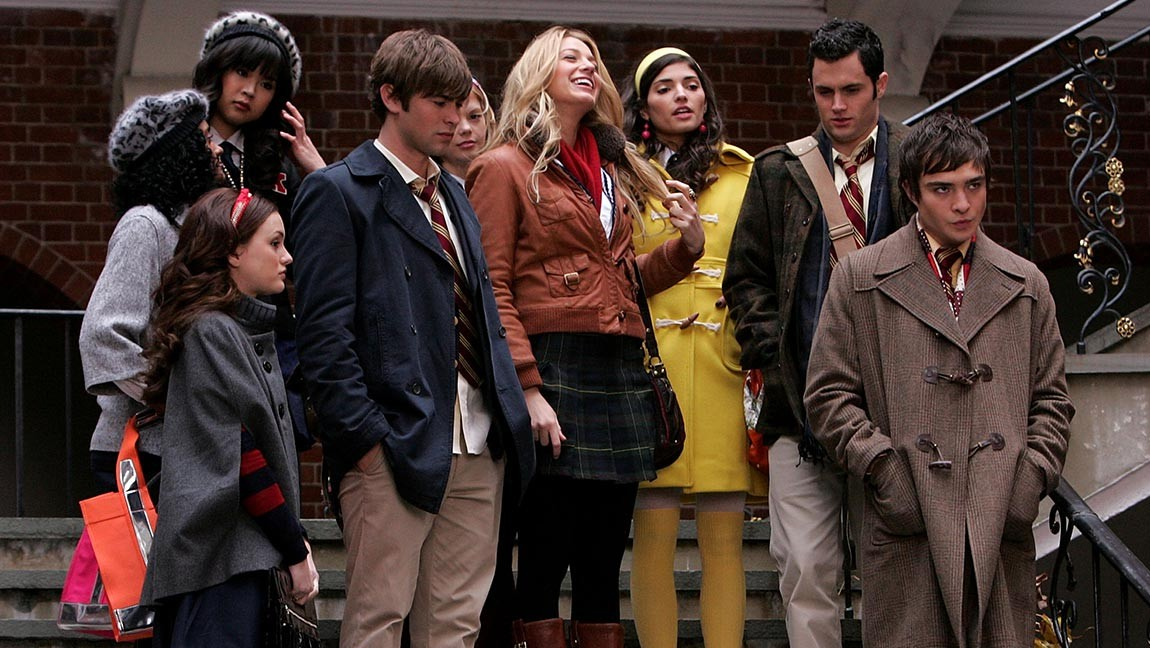 [Image description: The characters in Gossip Girl stand on the stairs of their high school. ] Via James Devaney