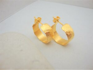 Image Description: Small Gold Hammered Hoop Earrings with a butterfly buckle. [Via Etsy]