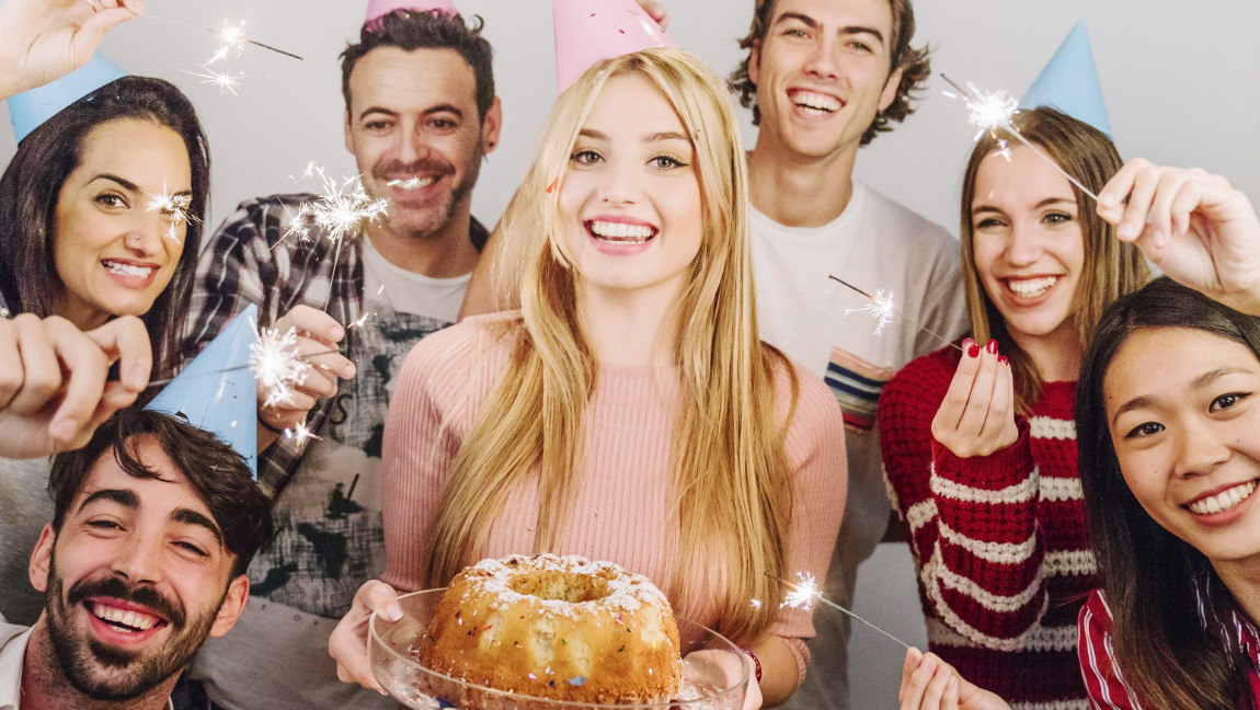 Group of people celebrating a birthday