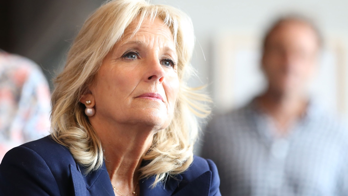A picture of Dr. Biden wearing a dark blue suit.