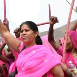 [Image description: Members from the Gulabi Gang protest in support of women's rights in India. ] Via Al Jazeera