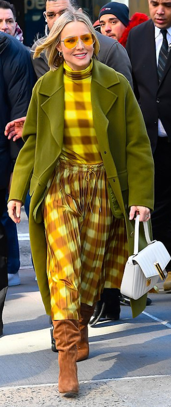 Kristen Bell in a yellow checkered outfit