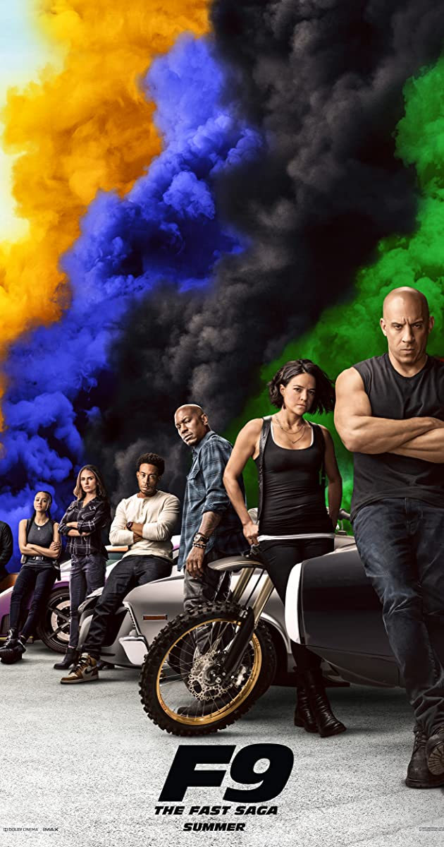 Fast & Furious 9 Movie Poster from IMDb of all the characters lined up behind each other leaning on cars with colored smoke in the background