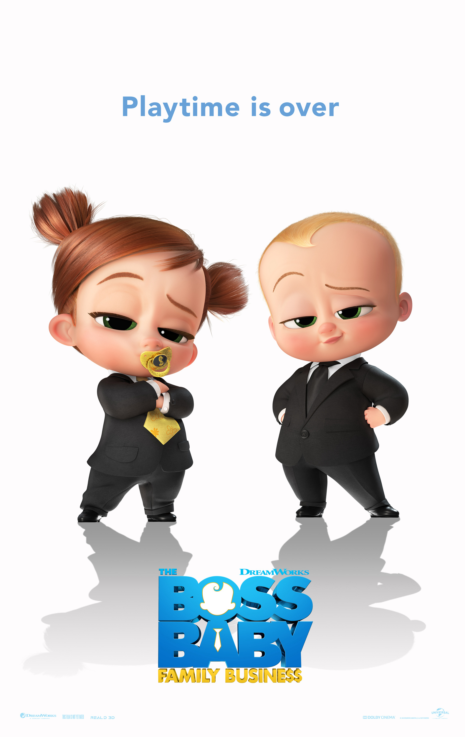 Image of a baby girl and boy in suits