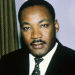 [Image description: photo of Martin Luther King in color.] via voxpopulisphere.files.wordpress.com