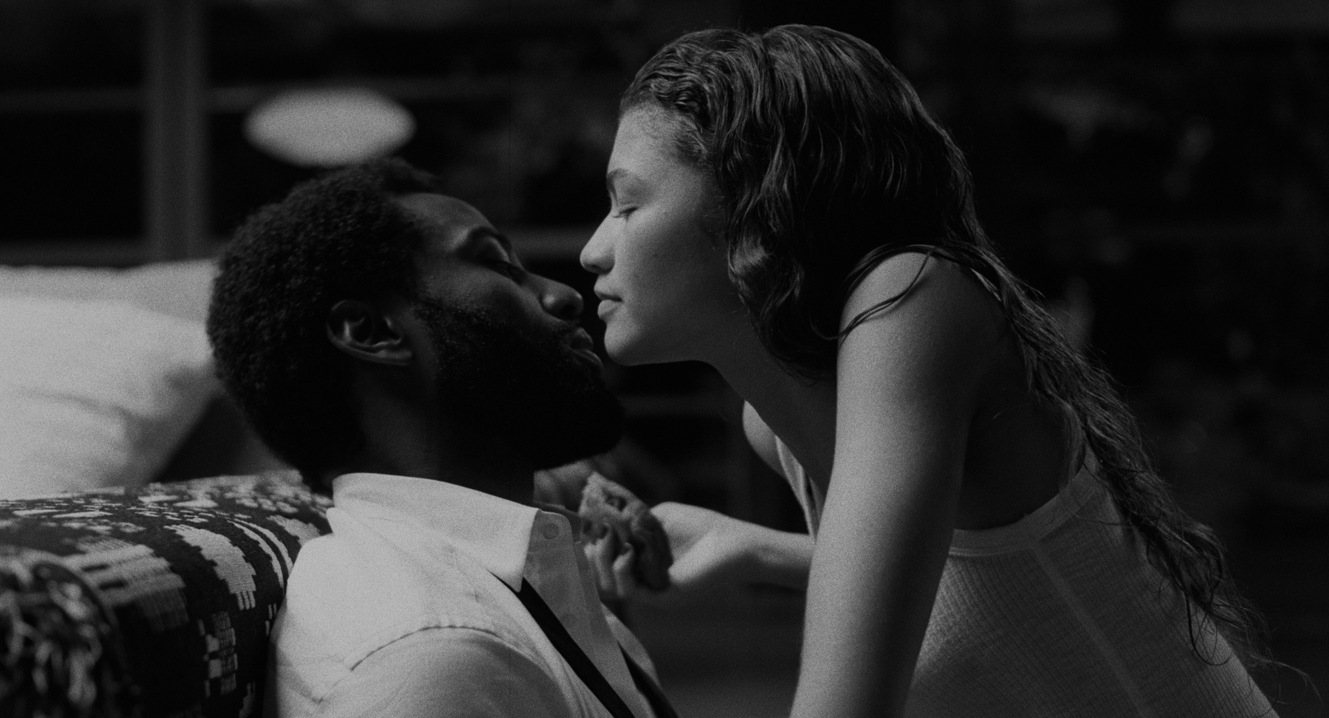 Black and White image of Marie almost kissing Malcom