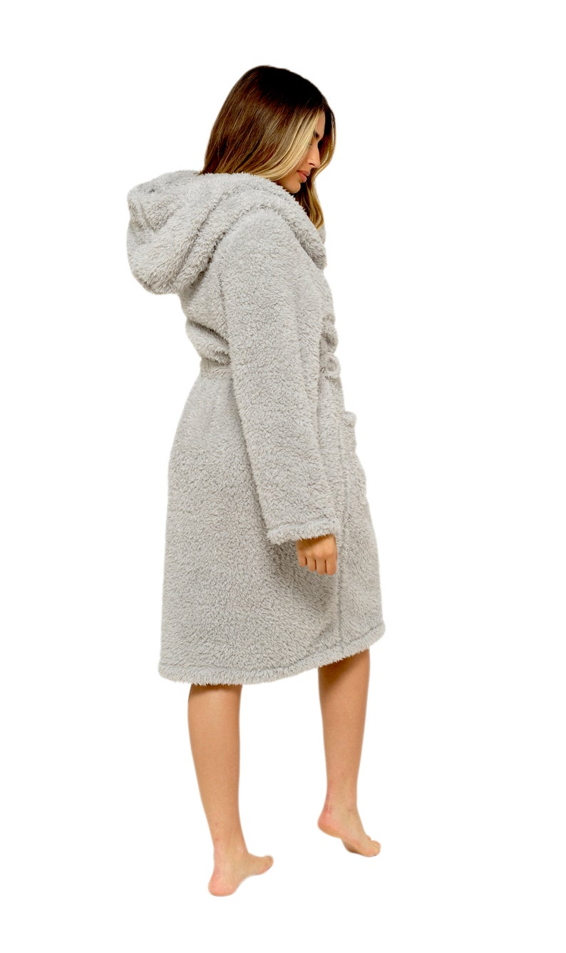 A woman wearing a gray fluffy dressing gown against a white background.