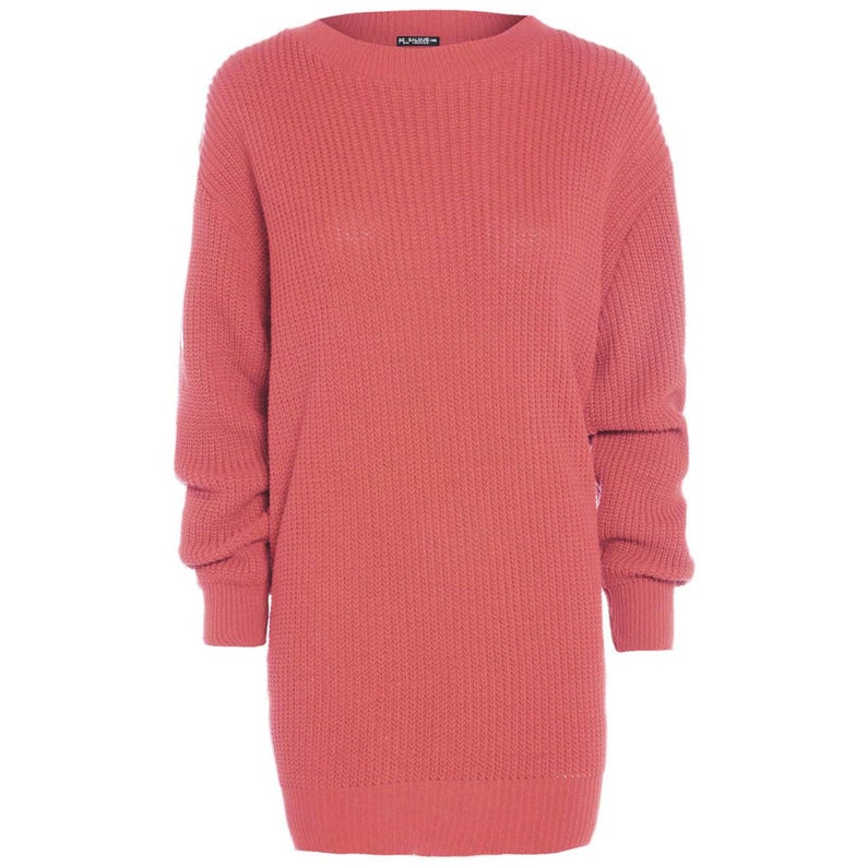 Pink sweater dress against a white background.