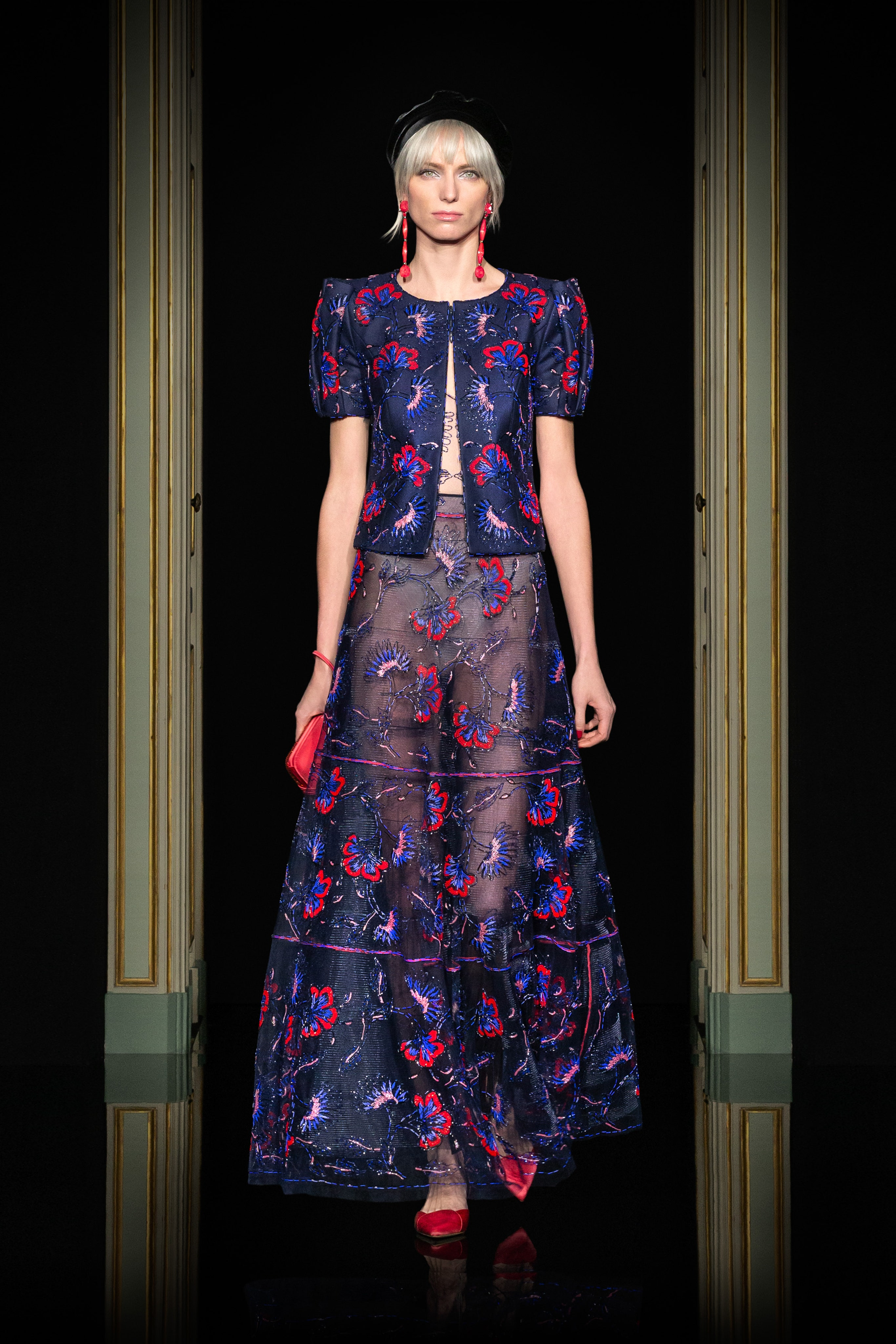 Armani Privé Spring 2021 Couture. A lady wearing a sheer midnight blue floral embroidered dress and bolero jacket.