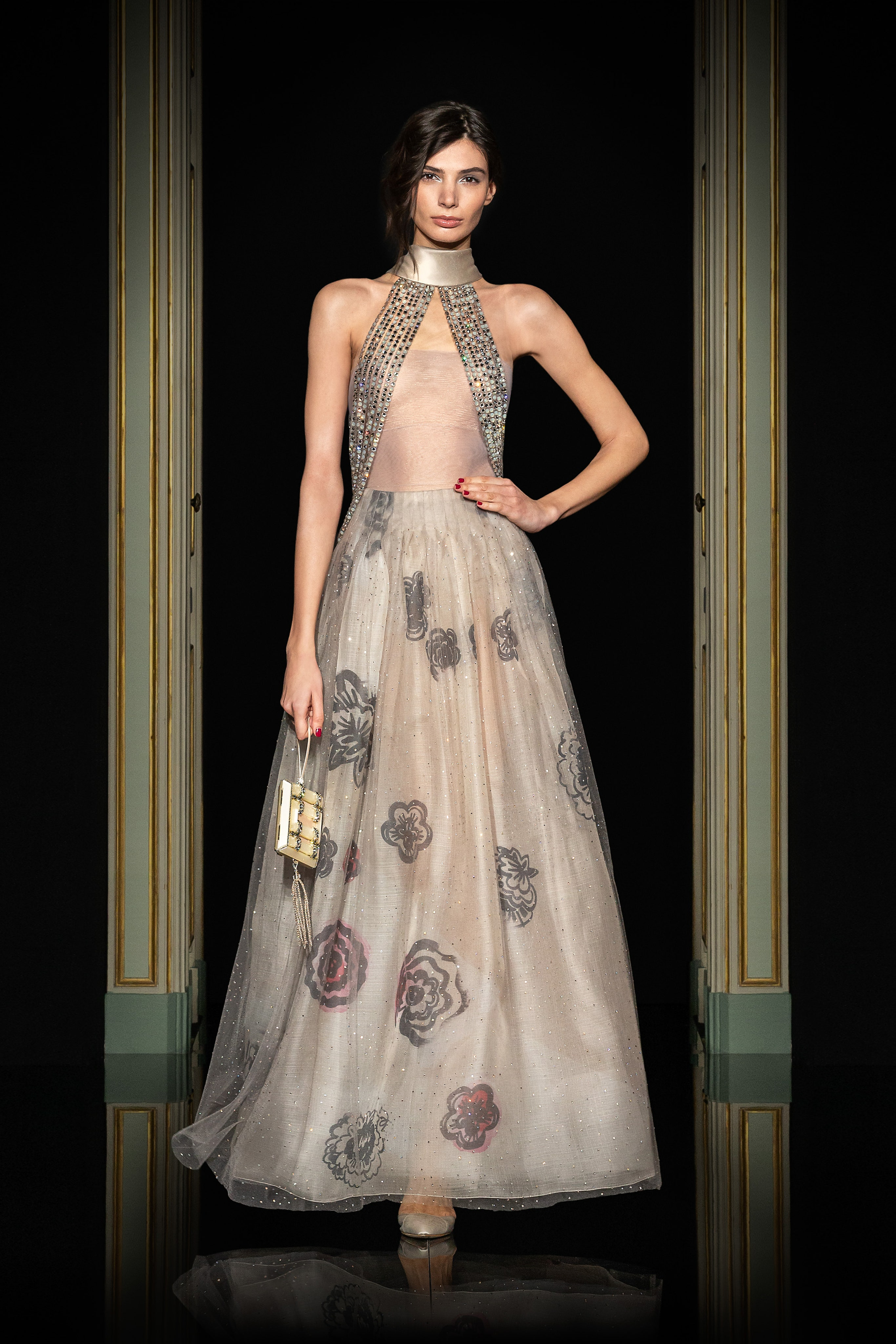 Armani Privé Spring 2021 Couture. A lady wearing a a gray gown with silver beading on the bodice and silver floral work on the skirt.