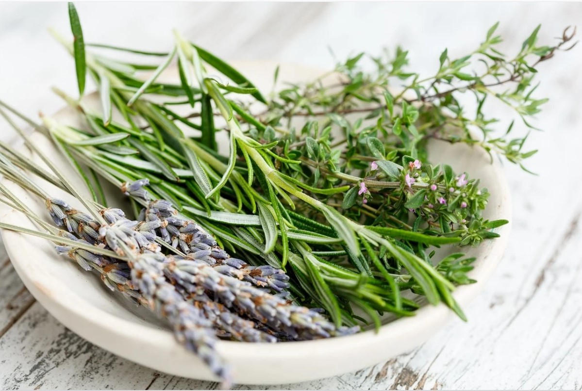 A bowl of herbs used for herb bouquets at weddings.