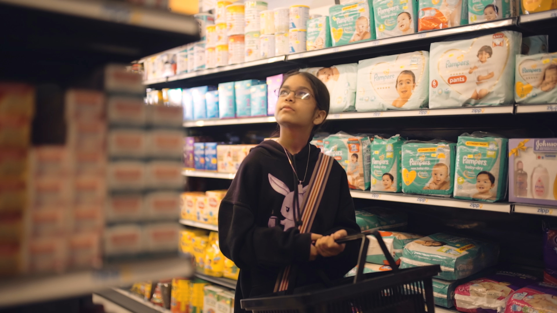 """A photo of a young girl at the grocery store, from the """"Bekhudi"""" music video."""