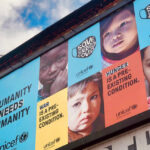 [Image Description: A billboard sign in London about UNICEF's campaign about child hunger in UK] Via Unsplash