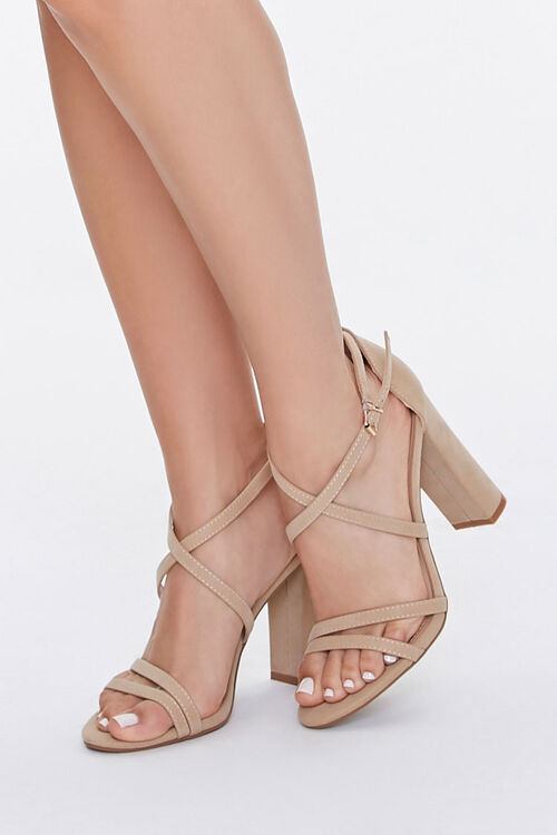 A pair of nude-colored block heels.