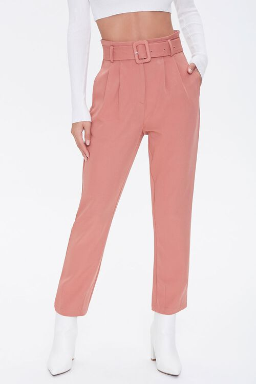 A pair of pink pleated ankle pants.