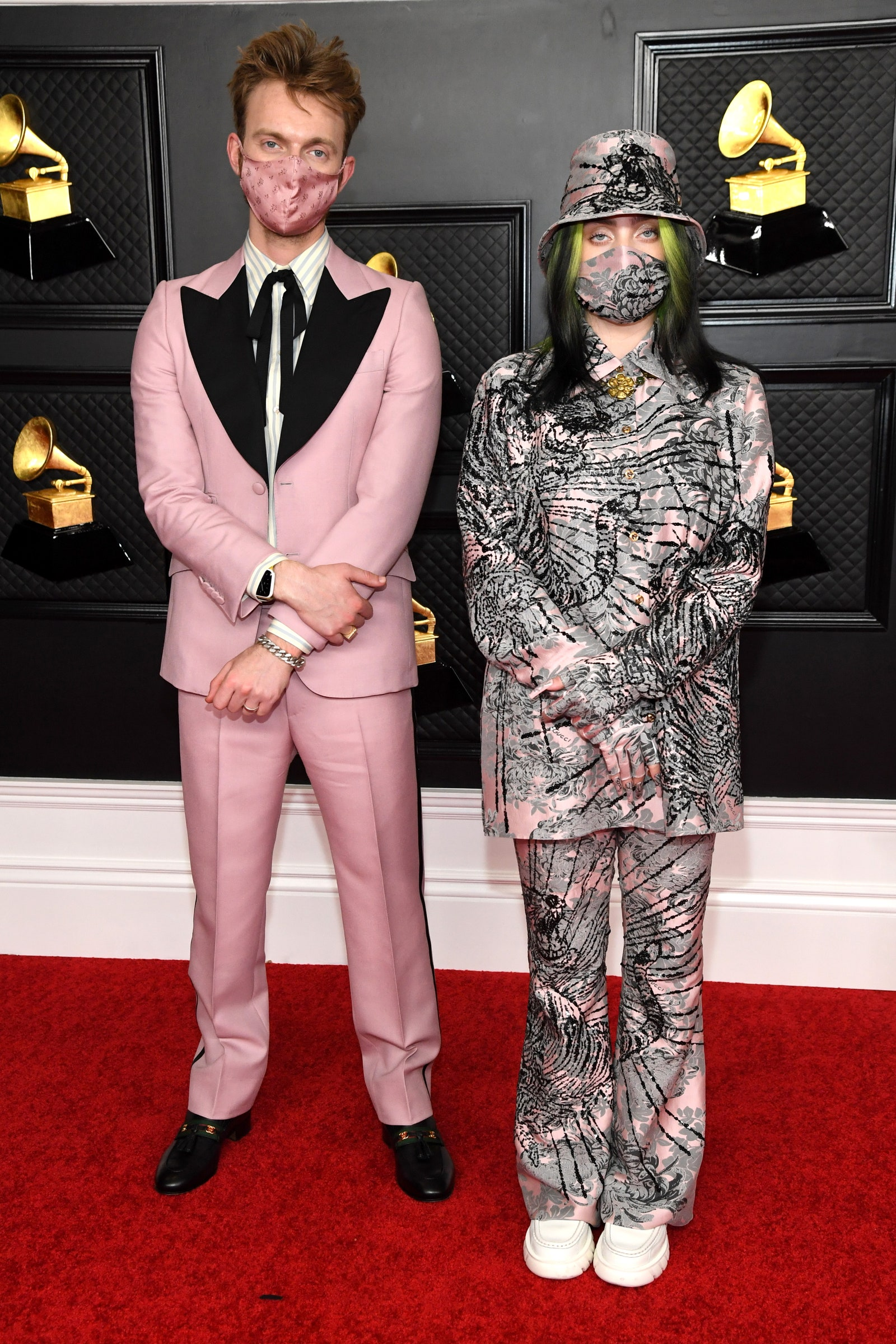 FINNEAS and Billie Eilish posing on the red carpet at the Grammys 2021.
