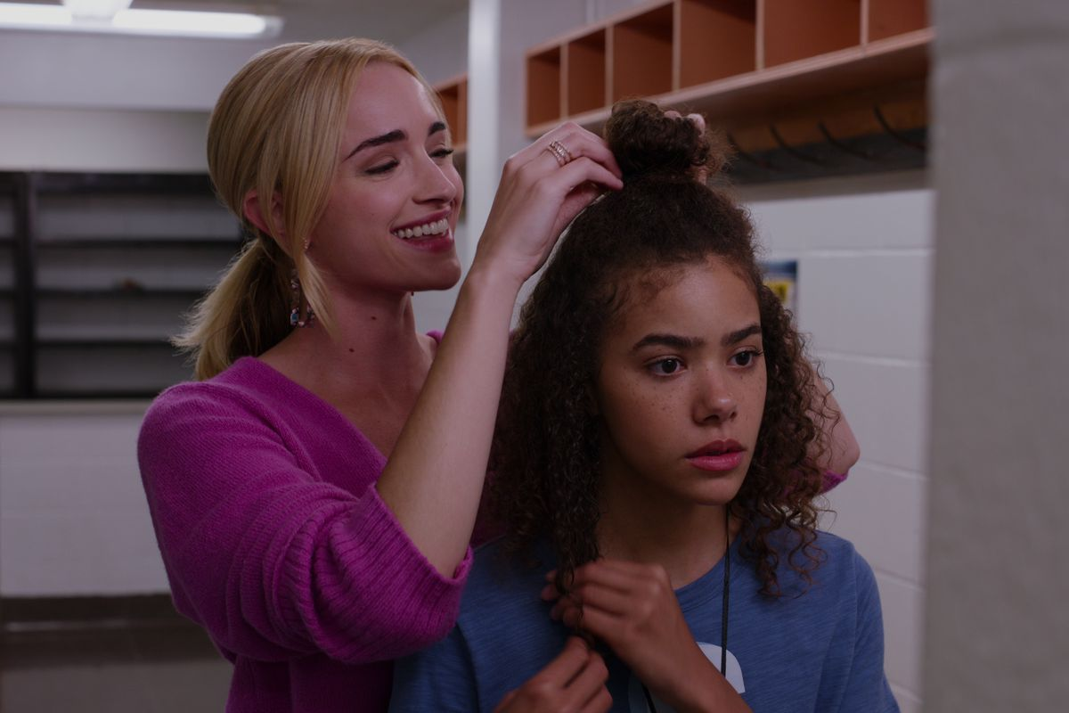 [Image description: Ginny and Georgia bonding over while the mother does her daughter's hair] Via Netflix