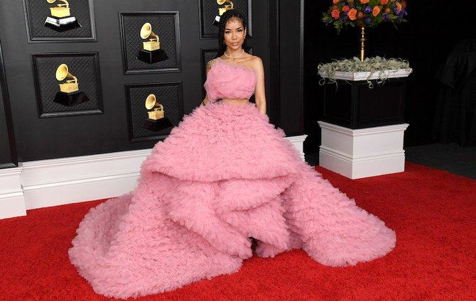 Jhene Aiko posting on the red carpet at the Grammys 2021.