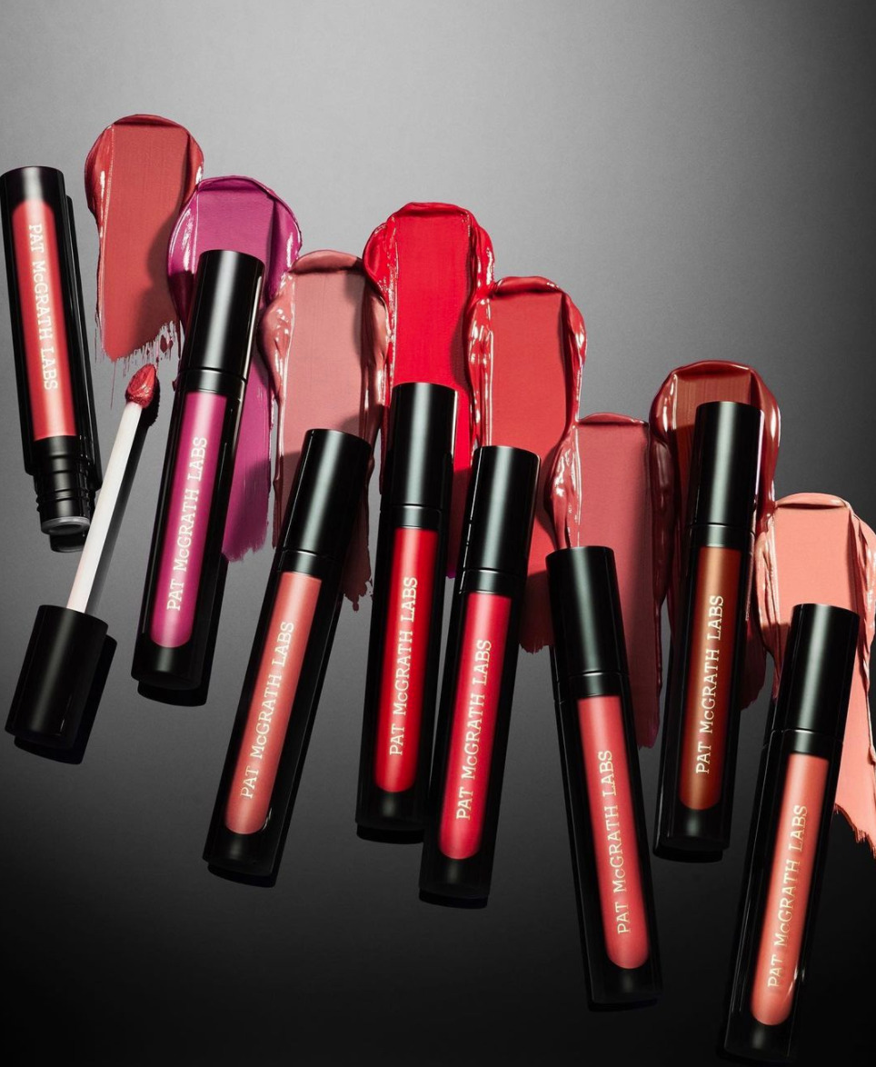 Eight lip gloss tubes in various shades