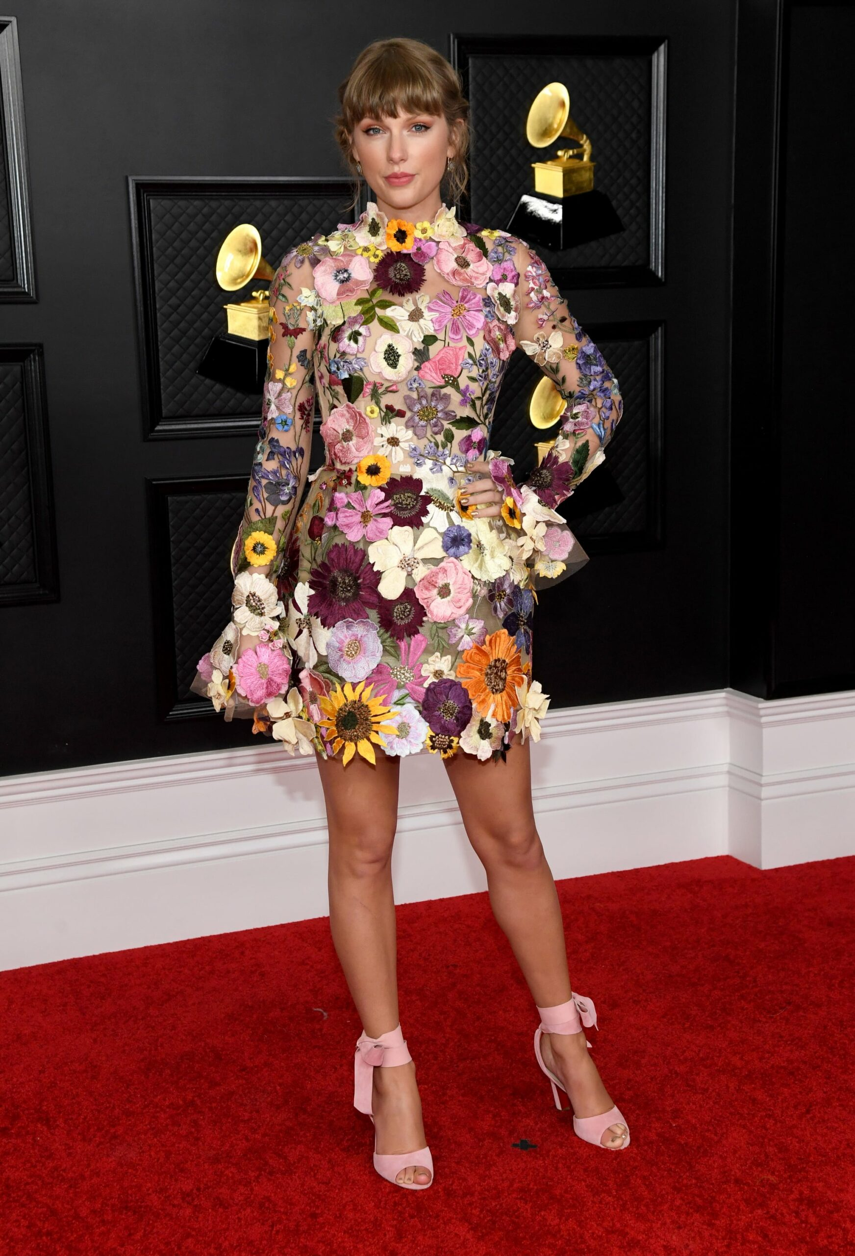 Taylor Swift posing on the red carpet at the Grammys 2021.