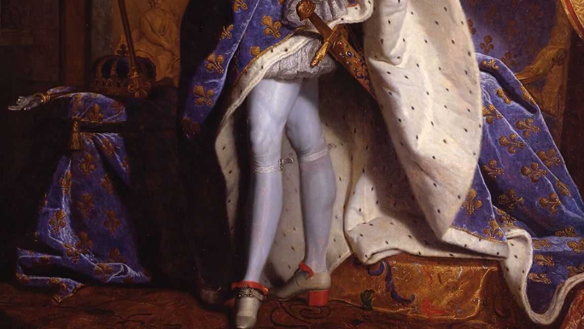 A close up shot of a painting of King Louis XIV's legs and his red heeled shoes.