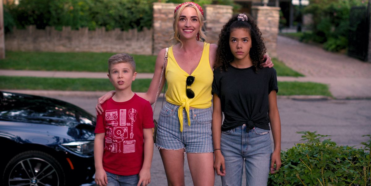 [Image description: Three people standing in the street. The girl in the middle smiles while the one on her right is frowning.] Via Netflix