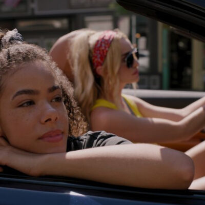 [Image description: Netflix's latest mother-daughter duo Ginny and Georgia seated in a car.] Via Netflix