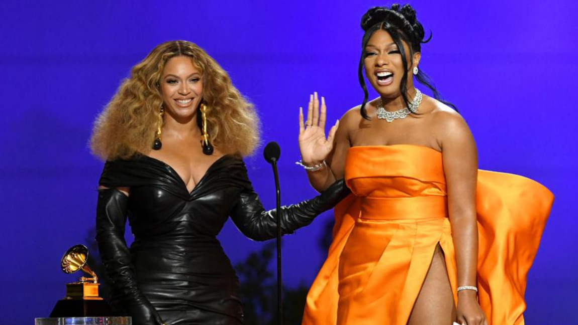 [Image description: Beyonce and Megan Thee Stallion at the Grammys 2021]