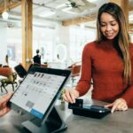A woman checks out with a cashier