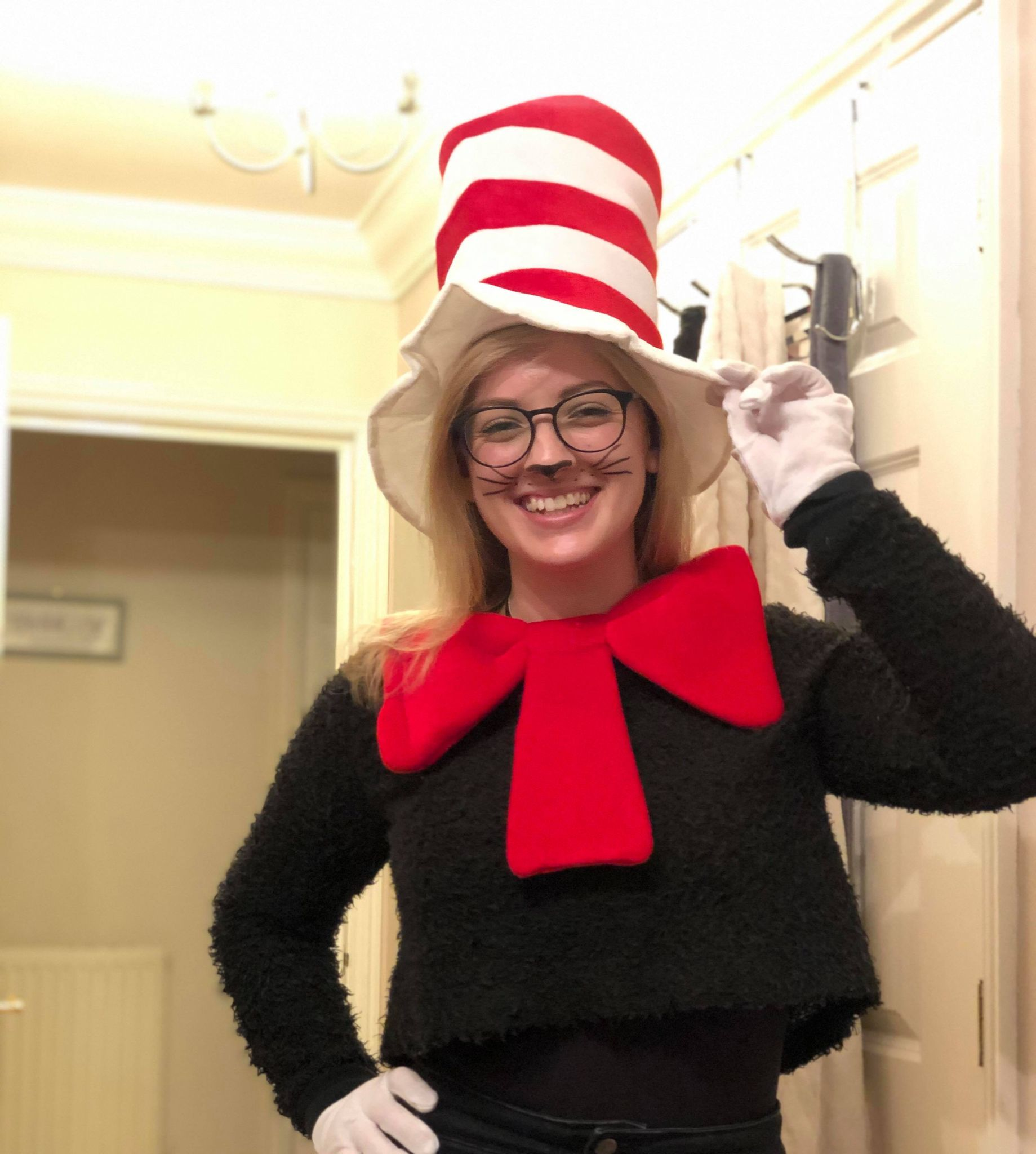 A Teaching Assistant dressed up as The Cat in the Hat, a character created by Dr. Seuss.