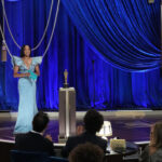 [Image Description: Oscar winning actress and director Rehina King on stage presenting at the 93rd Academy Awards.] via ABC News.