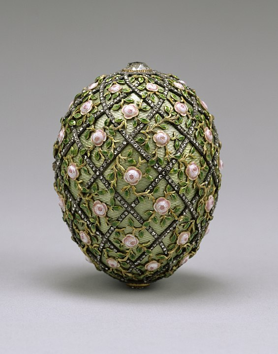 The Rose Trellis Faberge Egg with various colored gold embellishments.