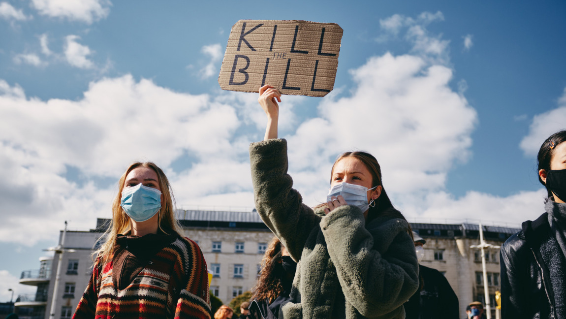 Two female protestors at the Kill the Bill protest in Leeds with a placard that says, 'Kill the Bill.'