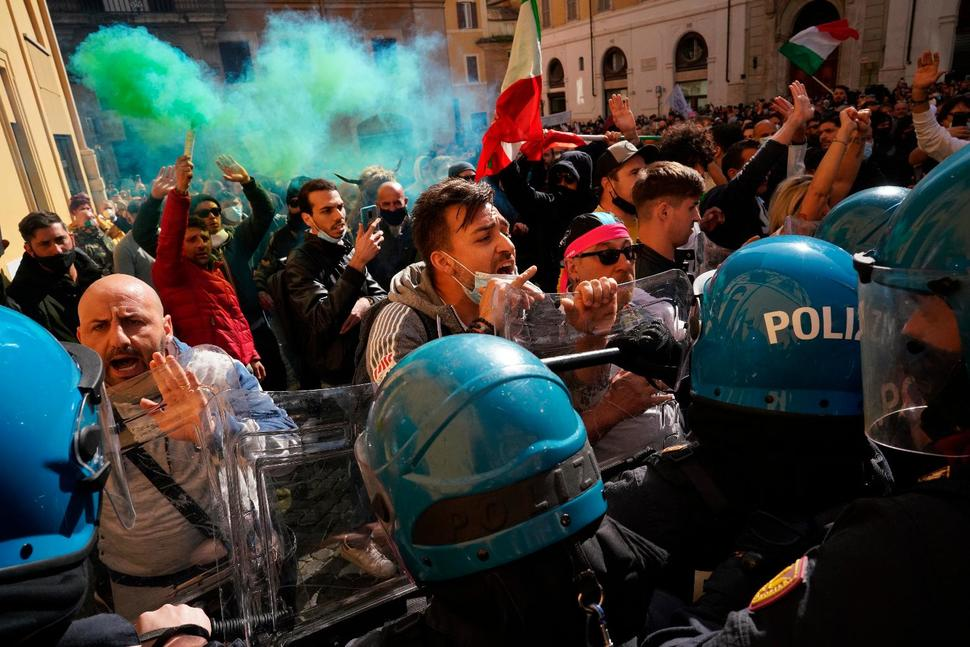[Image description: Protesters clash with police in Rome on April 6, 2021.] Via U.S. News & World Report