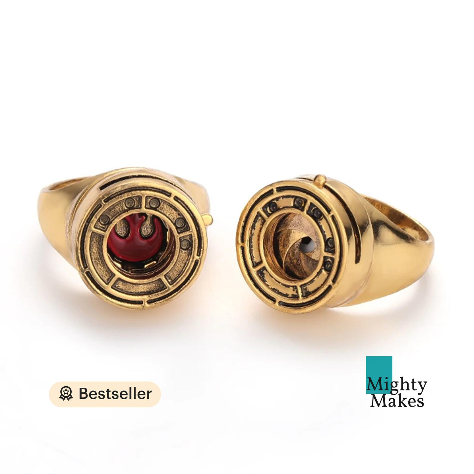 [Image description: a two image view of a gold replica Resistance ring]