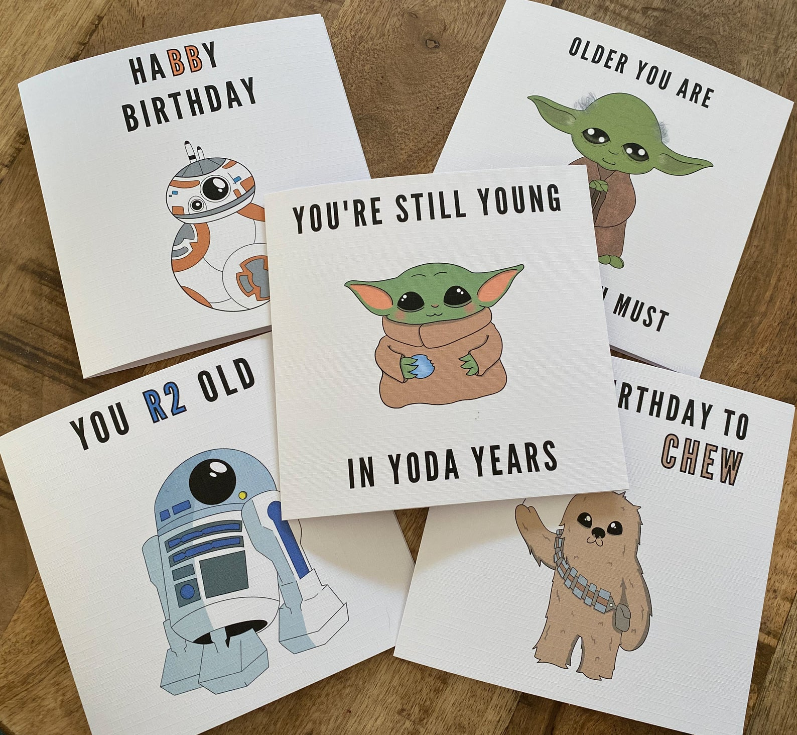 [Image description: five birthday cards with art work of Star Wars characters and cutesy captions]