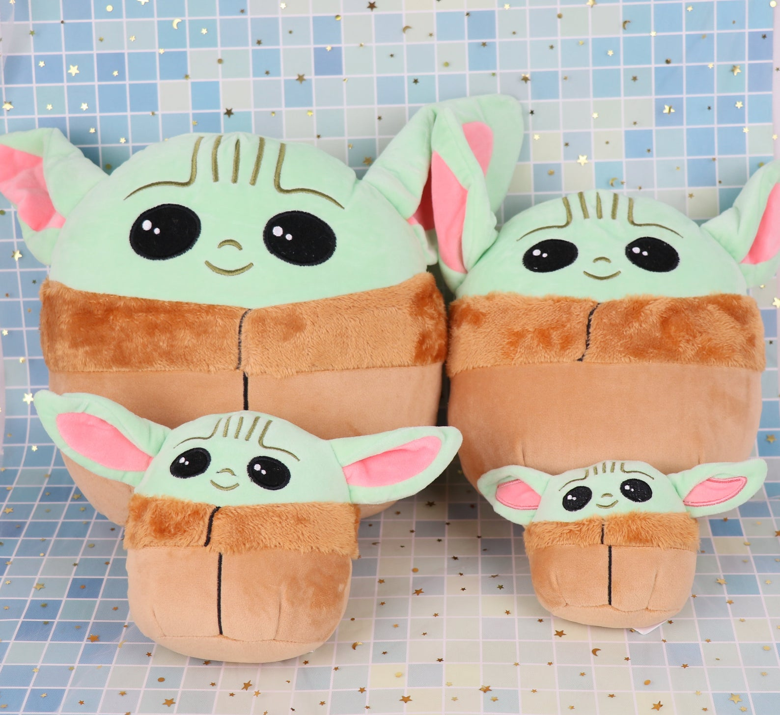 [Image description: four different sizes of a pillow shaped like Baby Yoda]