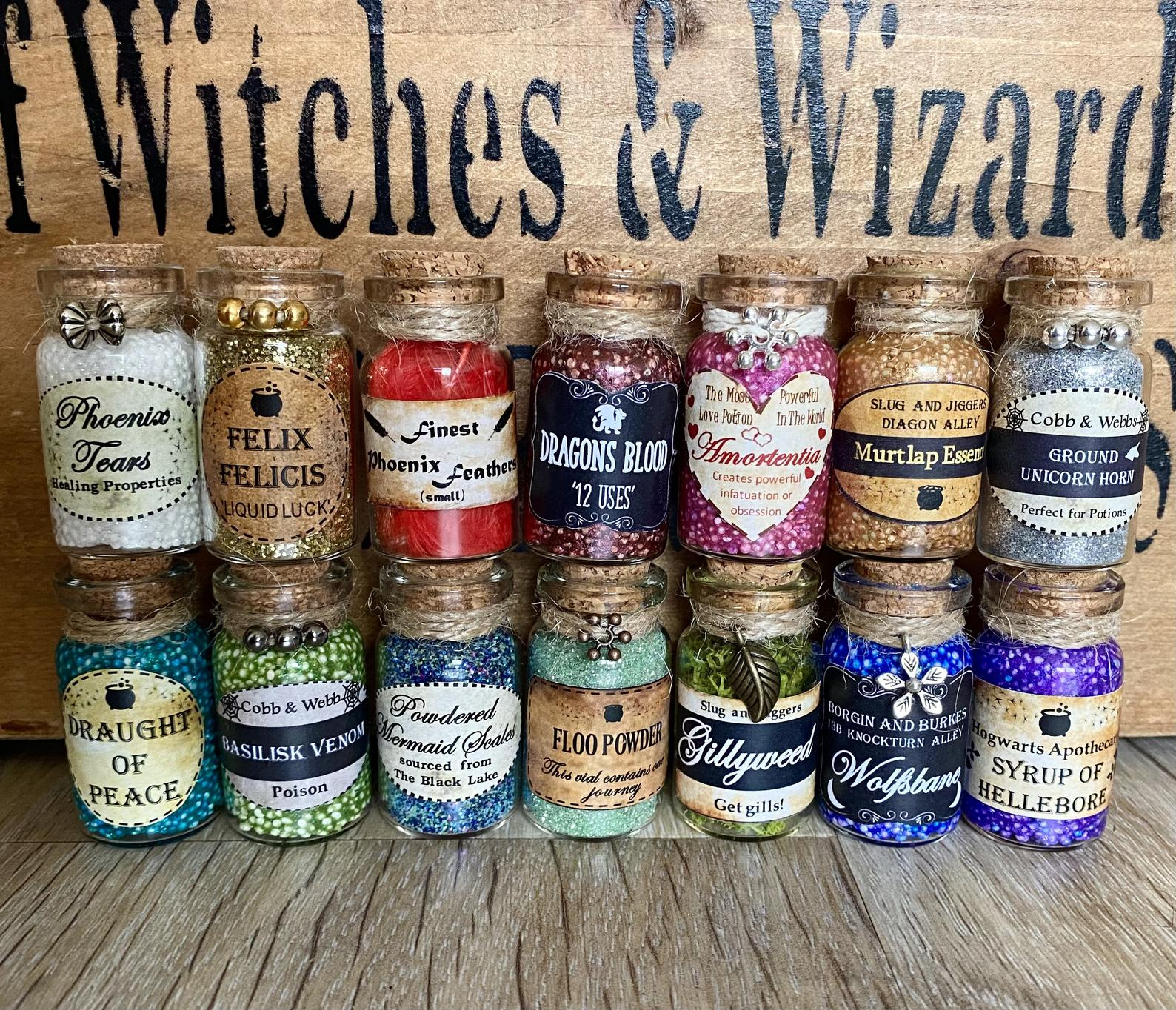 [Image description: a bunch of colourful mini bottles with labels denoting various Harry Potter potions and ingredients] via Etsy