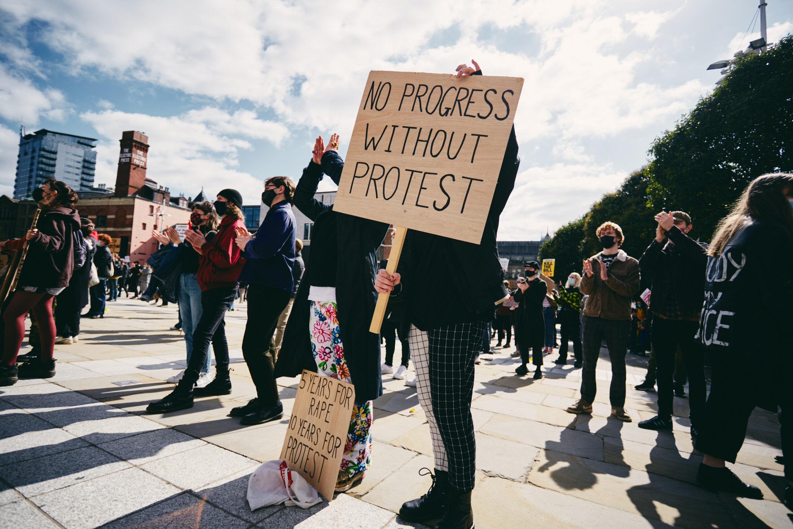 Protestor at a Kill the Bill protest with a placard that says, 'No progress without protest.'