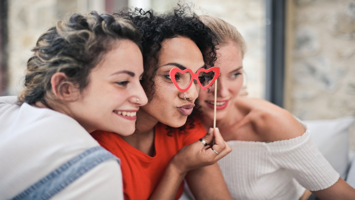 [Image description: three women smiling together] Photo by Adrienn from Pexels