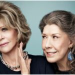 """Grace and Frankie pictured from the show """"Grace and Frankie"""". Frankie looks amicably at Grace but Grace holds up a hand to her inching away."""