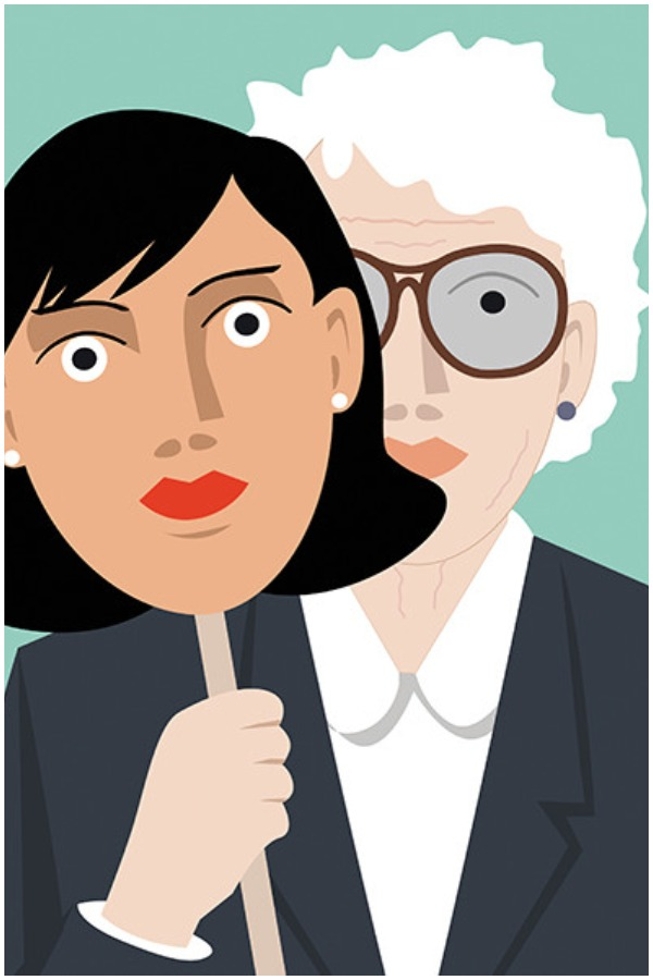 An older woman stands in a business suit holding up the mask of the face of a much younger woman