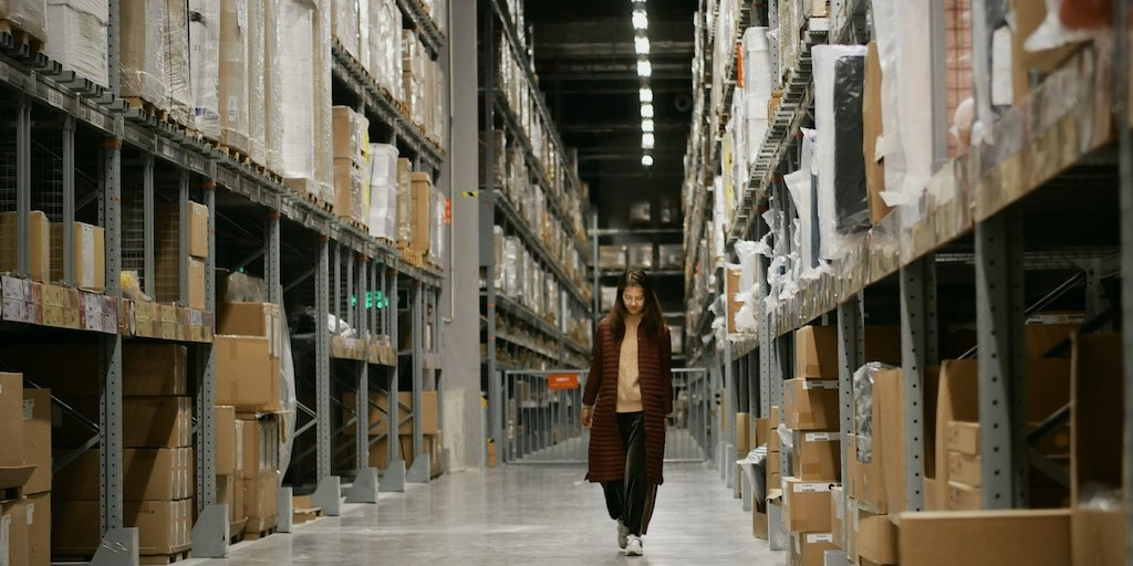 Woman walks through warehouse