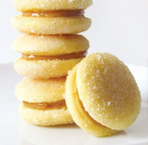 Four bem casados with white sponge cake cookies and dulce de leche filling
