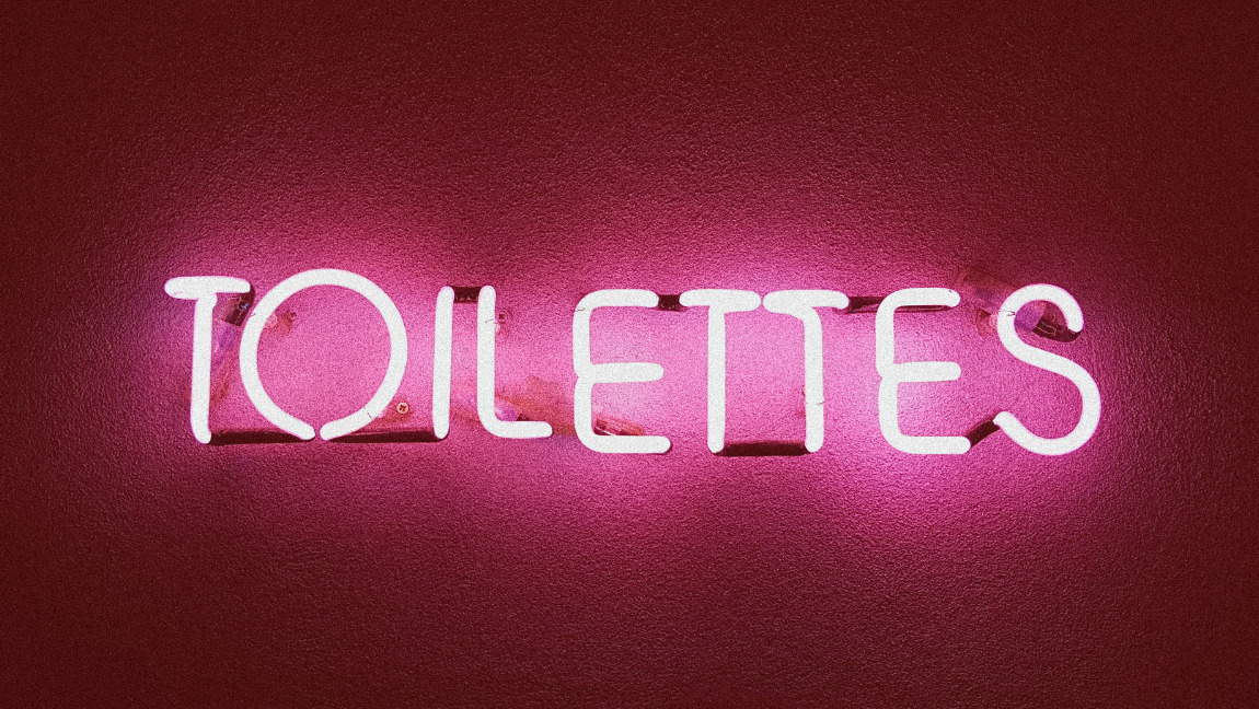 Neon pink 'toilettes' sign