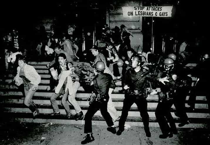 [Image description: Police clash with people during the Stonewall Riots of 1969.] Via hankeringforhistory.com