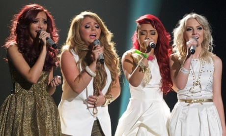 Image Description: (left to right) Jade Thirlwall, Jesy Nelson, Leigh-Anne Pinnock and Perrie Edwards performing at the X Factor final 2011