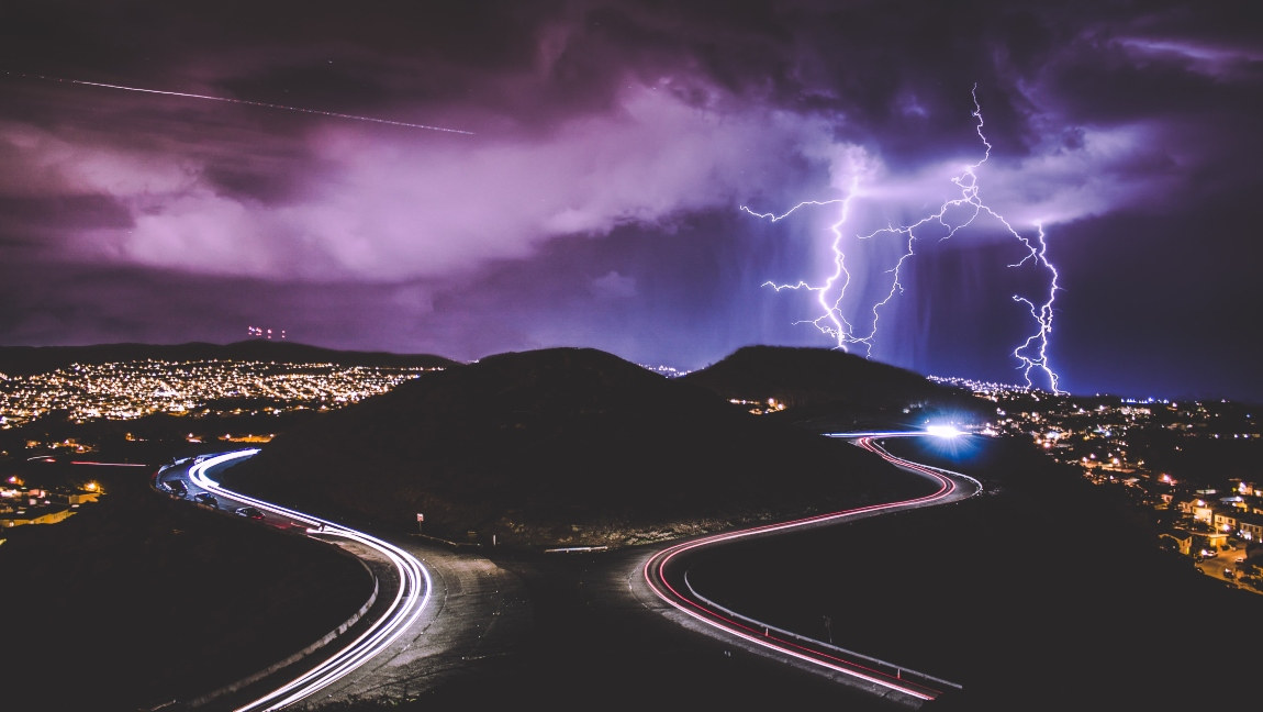 A photo of Twin Peaks in San Francisco, California, lit up by multiple lightning strikes