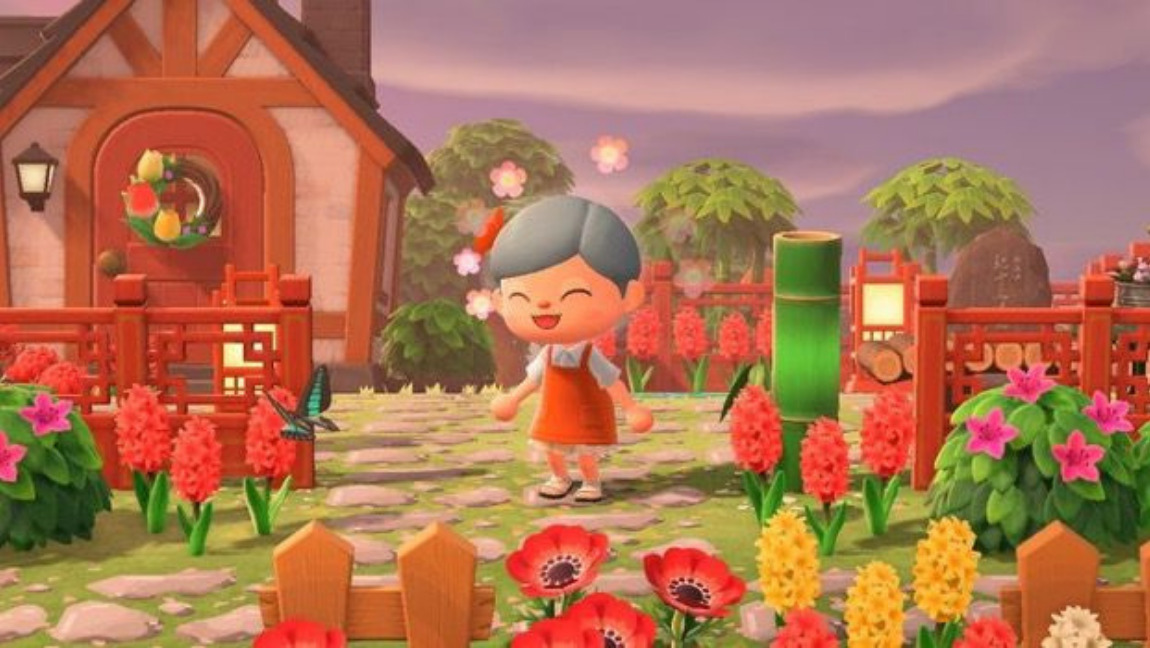 A screenshot from Animal Crossing New Horizons, with the main character smiling in front of her house.